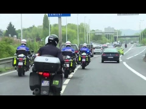 Macron returns to Paris