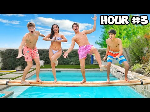 LAST TO FALL IN THE POOL WINS $1,000 CHALLENGE! **FREEZING**