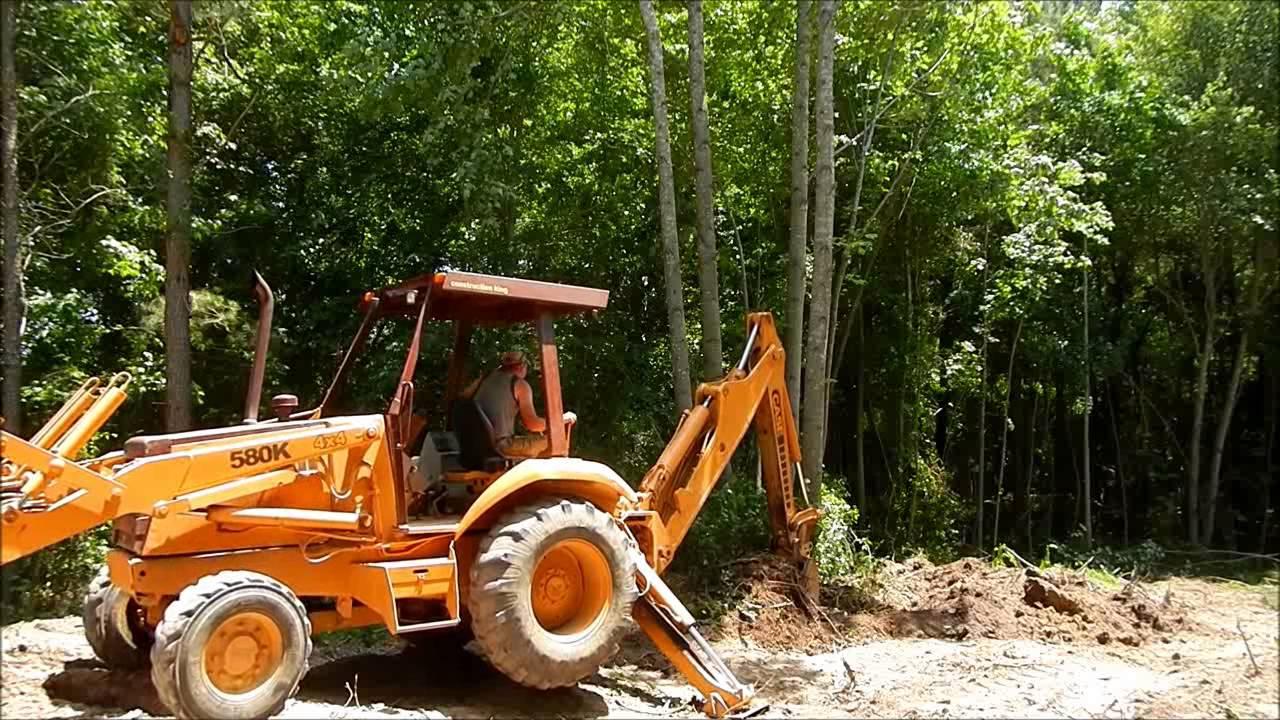 Case 580 Backhoe >> Case 580K Backhoe Clearing Trees - YouTube