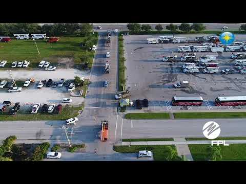 Aerial footage of Florida Power and Light's mini city in Sarasota and it power restoration work. [Pr