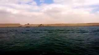 شاهد أعمال نقل رمال الحفر بقناة السويس الجديدة  لتدعيم جسور قناة السوبيس الحالية