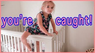 toddler-caught-sneaking-out-of-her-crib