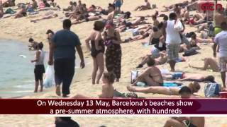 Pre-summer mode engaged for Barcelona's beaches as temperatures rise, but few dare to swim