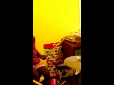 Kennedy plays the Drums at age 2, by Mimi Smith