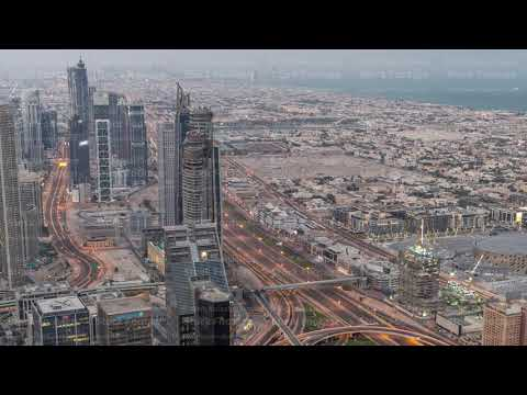 Dubai Downtown skyline futuristic cityscape with many skyscrapers and Burj Khalifa aerial night to