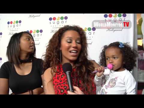 Melanie Brown aka Mel B and family arrive at Sugar Factory Hollywood Grand