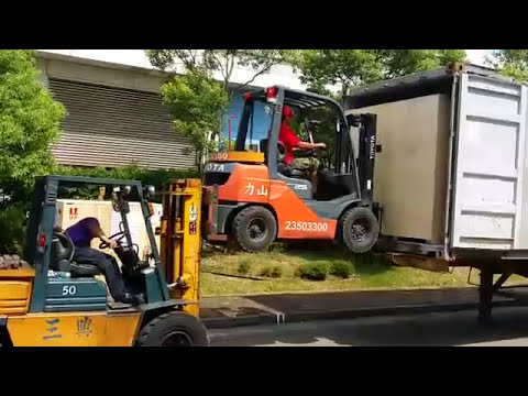 Movers Use Forklift to Lift Forklift