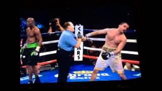 Referee hitting boxer