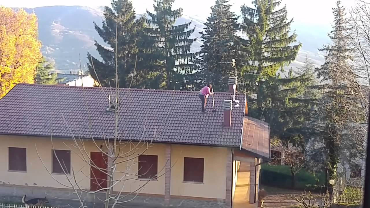 Attractive Fat Crazy Woman Cleaning Gutters On His House Roof