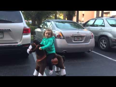 Ara rides the Pony Bike