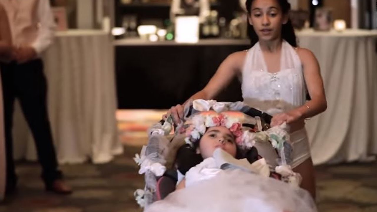 12 Year Old Girl Dances With Sister In Wheelchair To Surprise Mom At