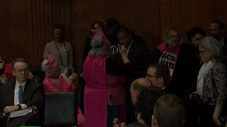 'No to ban on refugees': Protester interrupts Committee Vote on Attorney General Nomination