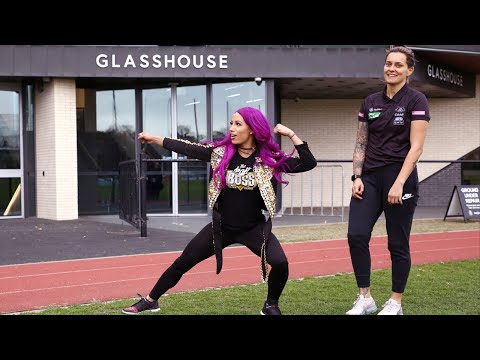 Sasha Banks kicks back with AFL's Moana Hope