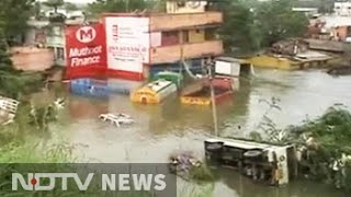 Rain stops, but water increasing in Chennai. Here