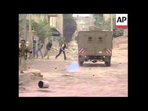 Violence erupts at refugee camp, protests in Gaza