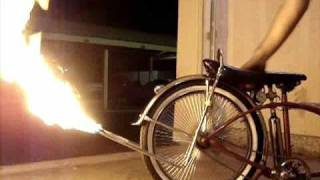 first lowrider bike with air bags and shoots fire