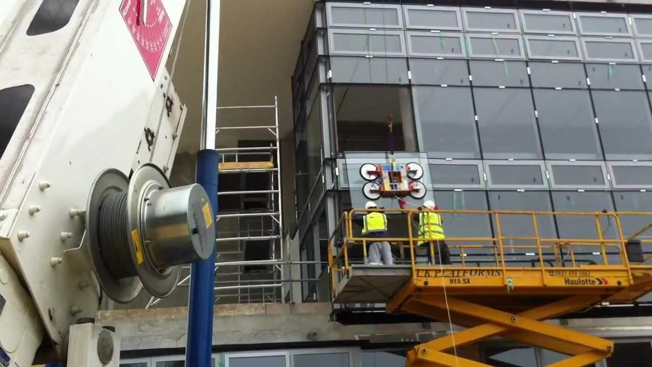 Trailer Crane Installing Curtain Wall Glazing Youtube