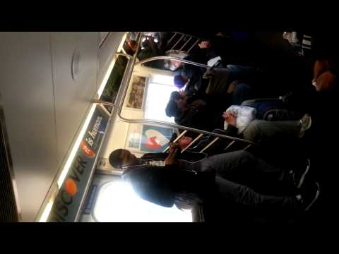 Teenage girls fighting on NYC train