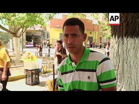 Venezuelans struggle with cash shortages