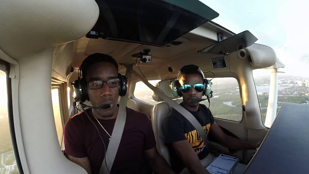 Young Brothers Flying a Cessna 172 Over Miami Beach