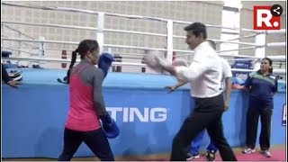 Sports Minister Rajyavardhan Singh Rathore In A Friendly Boxing Bout With Boxing Champion Mary Kom