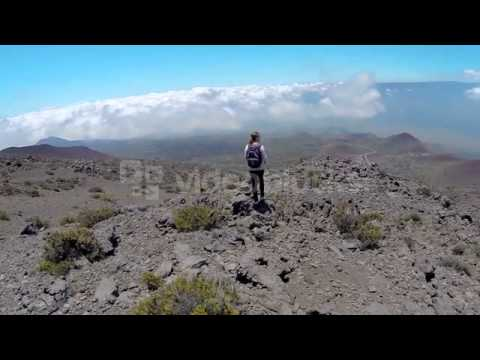 Woman Looking Out on Epic Mountain Landscape Stock Video Footage