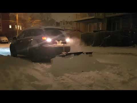 Wooden snowplow in action