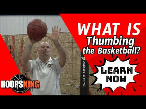 What does Thumbing the Basketball Mean with your Guide or Off Hand?