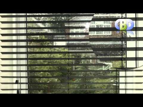 BayWoodenVenetianBlinds with Curtains at www.leadinginteriors.com