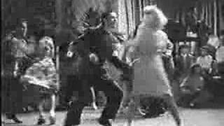 Swing Dancing from the Movie Twiced Blessed (1945)(Swing Dancing from the Movie Twiced Blessed (1945). Some square cats try their best in a swing dance contest. Dancers cutting a major rug - Hal Takier & Alice ..., 2007-01-25T23:07:15.000Z)