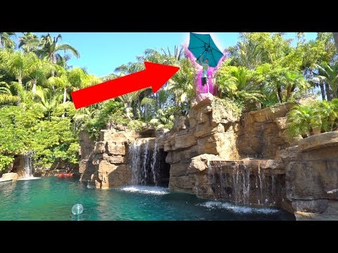 BACKYARD CLIFF JUMPING WITH HUGE UMBRELLAS!!