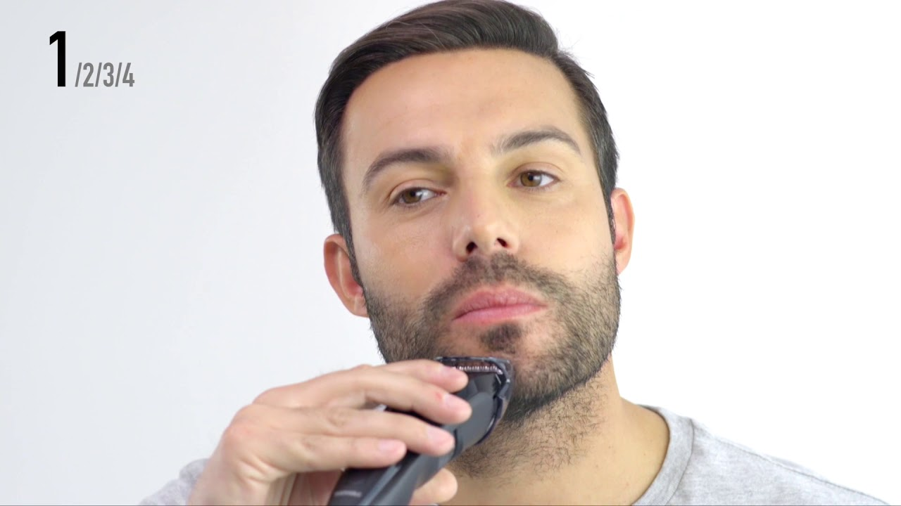 Man T Stubble In Front Of Mirror