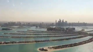 Flying over Palm Jumeriah Island in Dubai heading to the Burj Al Arab.