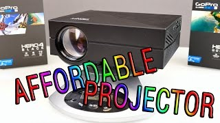 Super cheap projector - should this be your next one? TRONFY GM60(Get the projector here: http://bit.ly/1NNjYEr Your gateway to all of our content: http://www.itxtutor.com/ ↓↓↓↓↓↓↓↓↓↓↓ open for more information!, 2015-12-24T09:58:05.000Z)