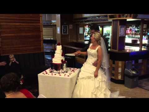 Ste & Tammy cutting the cake