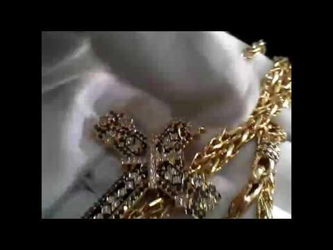 Эксклюзивная ювелирная работа крест из жёлтого золота с бриллиантами, синей эмалью на цепочке.