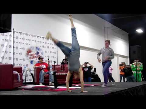 Amy Jo Johnson  pink ranger  performing a handstand at the TGPCC 2016