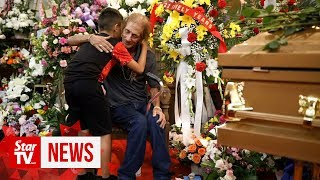 Hundreds show up in El Paso to mourn a woman they didn't know