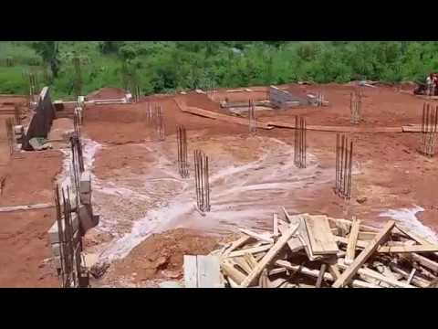 Building in Ghana, filling in the foundation.