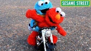 sesame street elmo cookie monster ride a toy motorcycle r c car crash