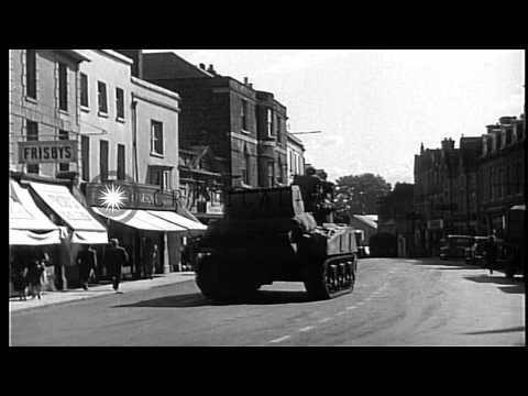 American military trucks and tanks pass through English village of shaftesbury, d...HD Stock Footage