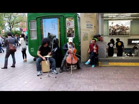 Street musicians playing at Shibuya station, Tokyo