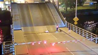 WATCH:  Bicyclist Escapes Serious Injury After Falling Between Bridges
