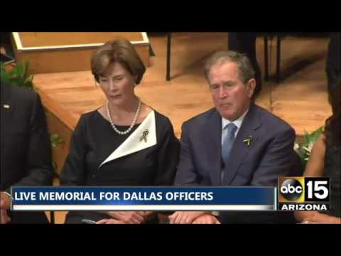 President Obama & President George W. Bush sit next to each other at Dallas Memorial