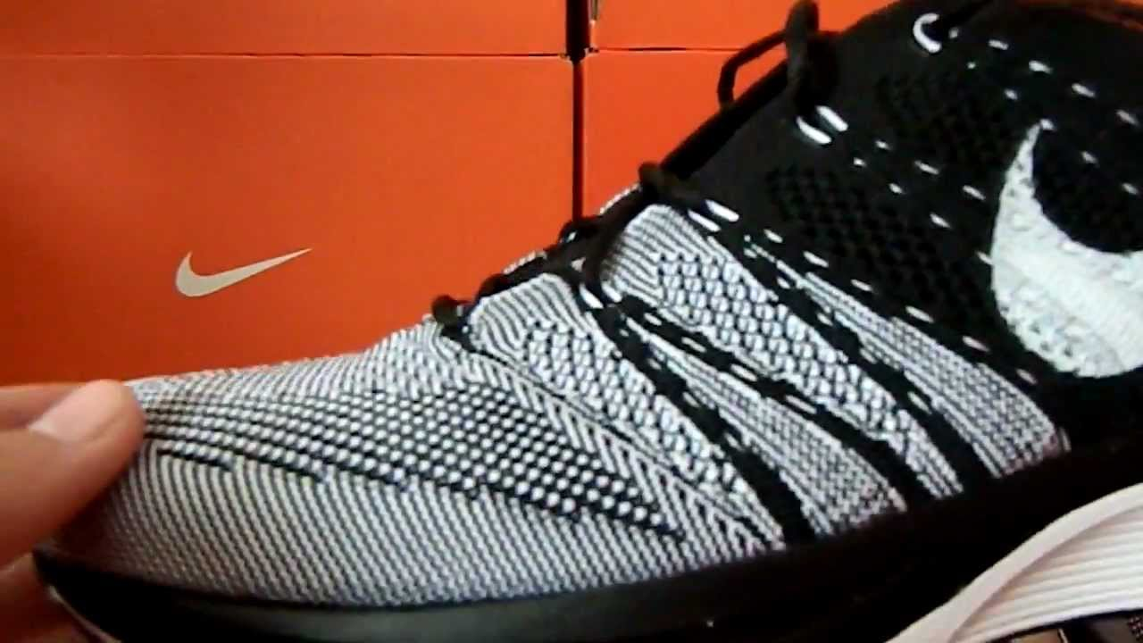 flyknit trainer black white