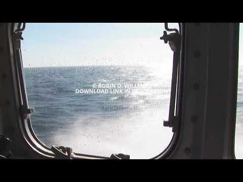 Interior window starboard side view of ocean from Pilot boat underway