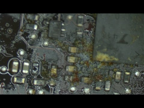 Dead Macbook Pro from feces like substance on current sensing circuit