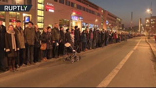 Hundreds of Germans form human chain to halt far right rallies on WWII Dresden bombing anniversary