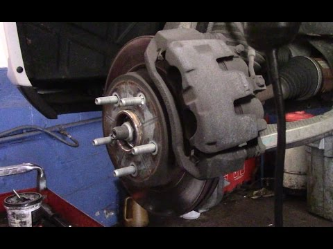 how-to-replace-the-front-brakes-and-rotors-on-a-2014-dodge-ram