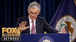 Federal Reserve cuts interest rate by a quarter percentage point
